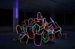 Illuminated string, 100 chair / UV-Light installation